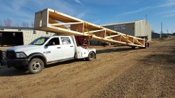 Company Truck Holding Wood, Roofing Solutions in Checotah, OK